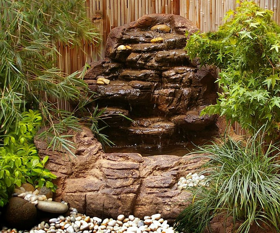 Small backyard corner pond waterfalls kits artificial rocks Backyard pond ideas with waterfall